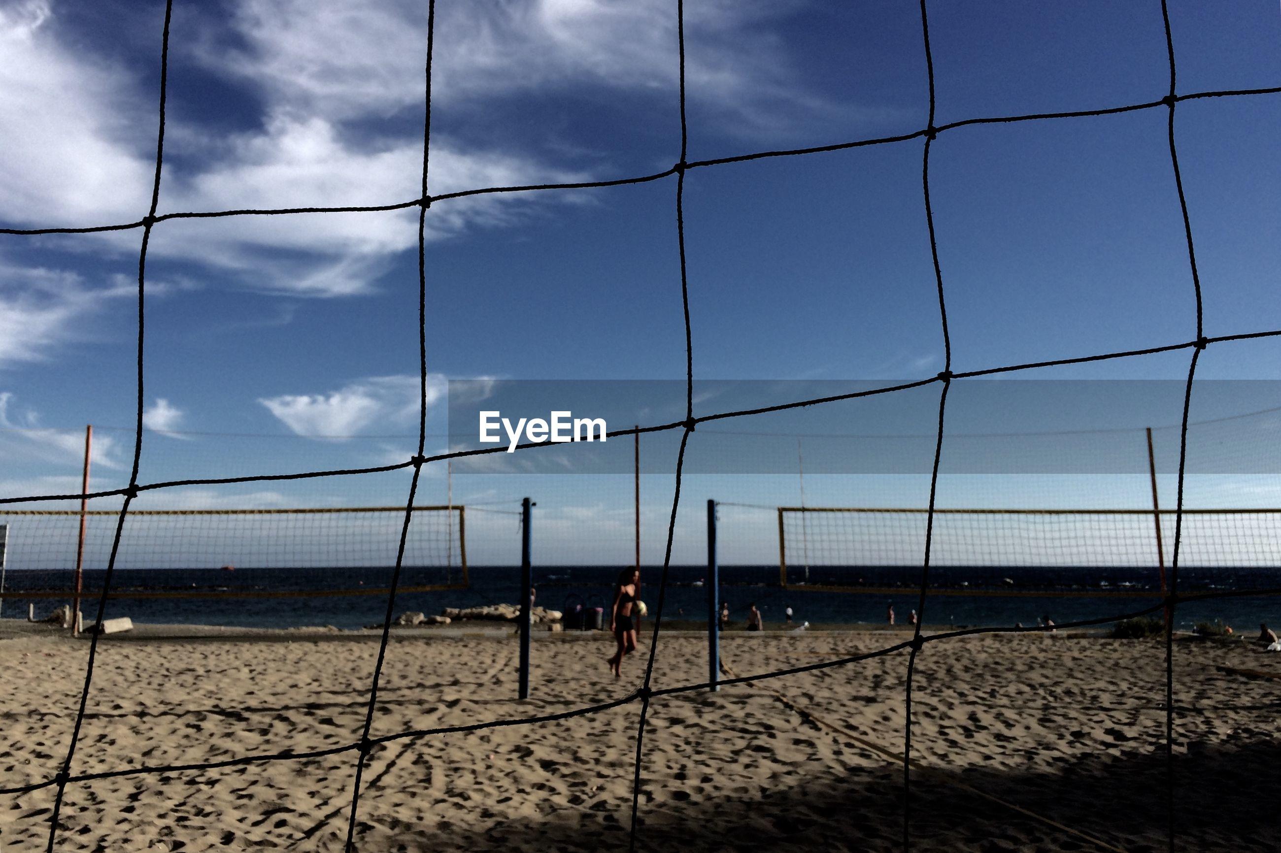 Netting at beach against sky