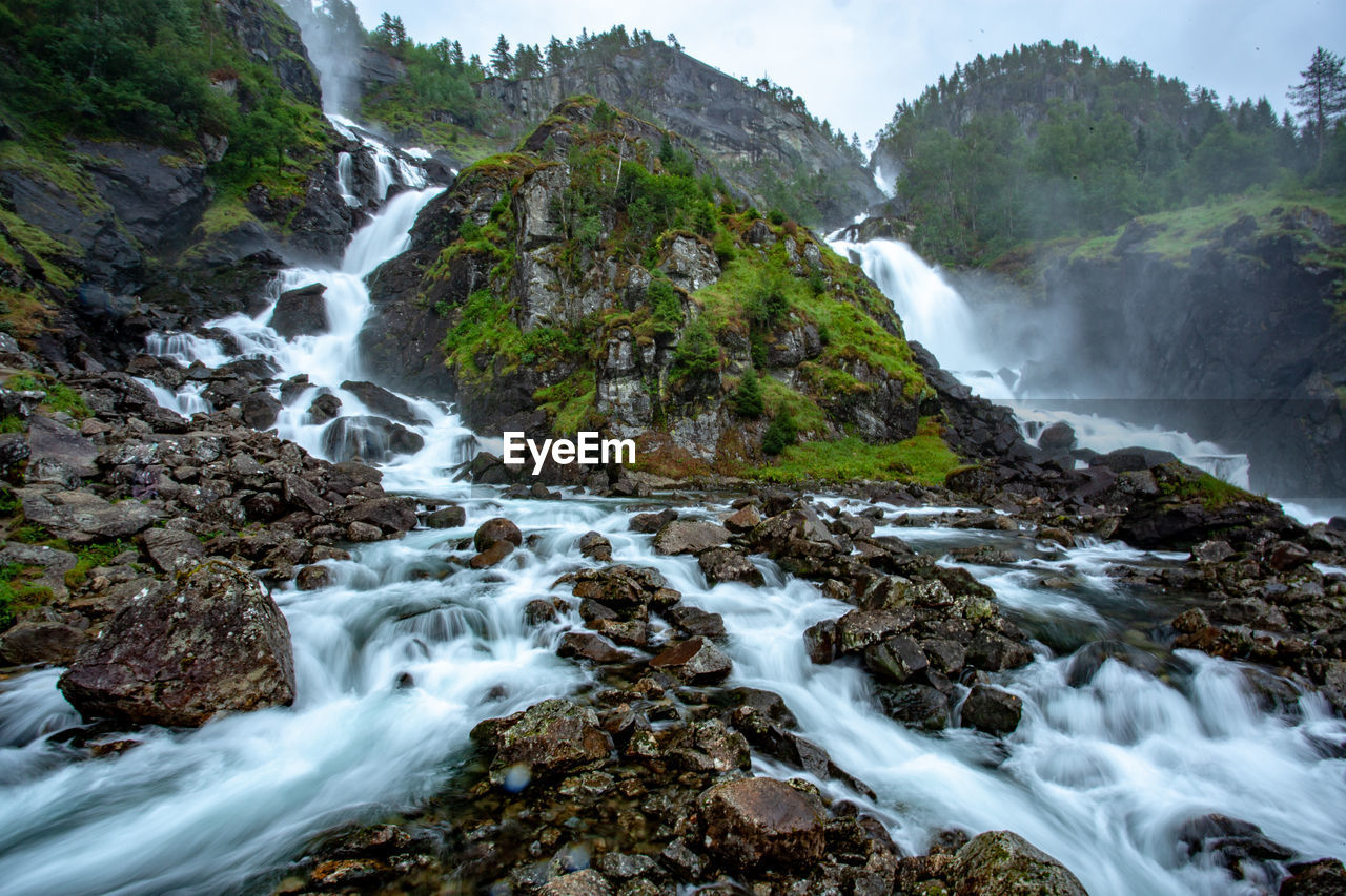 long exposure, scenics - nature, water, beauty in nature, rock, flowing water, motion, waterfall, solid, rock - object, blurred motion, land, nature, no people, non-urban scene, plant, forest, flowing, day, outdoors, power in nature, stream - flowing water, falling water, rainforest