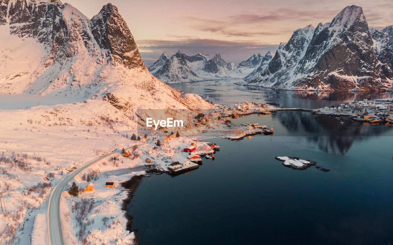 water, beauty in nature, mountain, scenics - nature, tranquil scene, tranquility, sky, mountain range, lake, nature, reflection, cold temperature, winter, non-urban scene, idyllic, snow, mode of transportation, nautical vessel, no people, snowcapped mountain