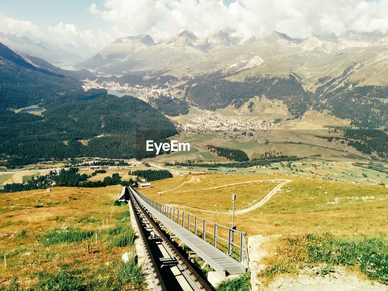Railroad Track In Front Of Mountains At Engadin