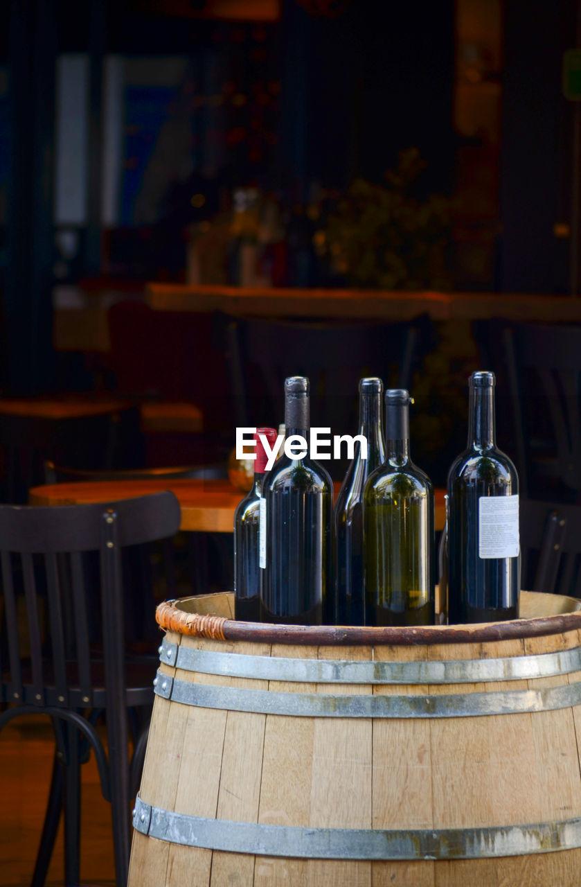 Wine Bottles On Barrel At Restaurant