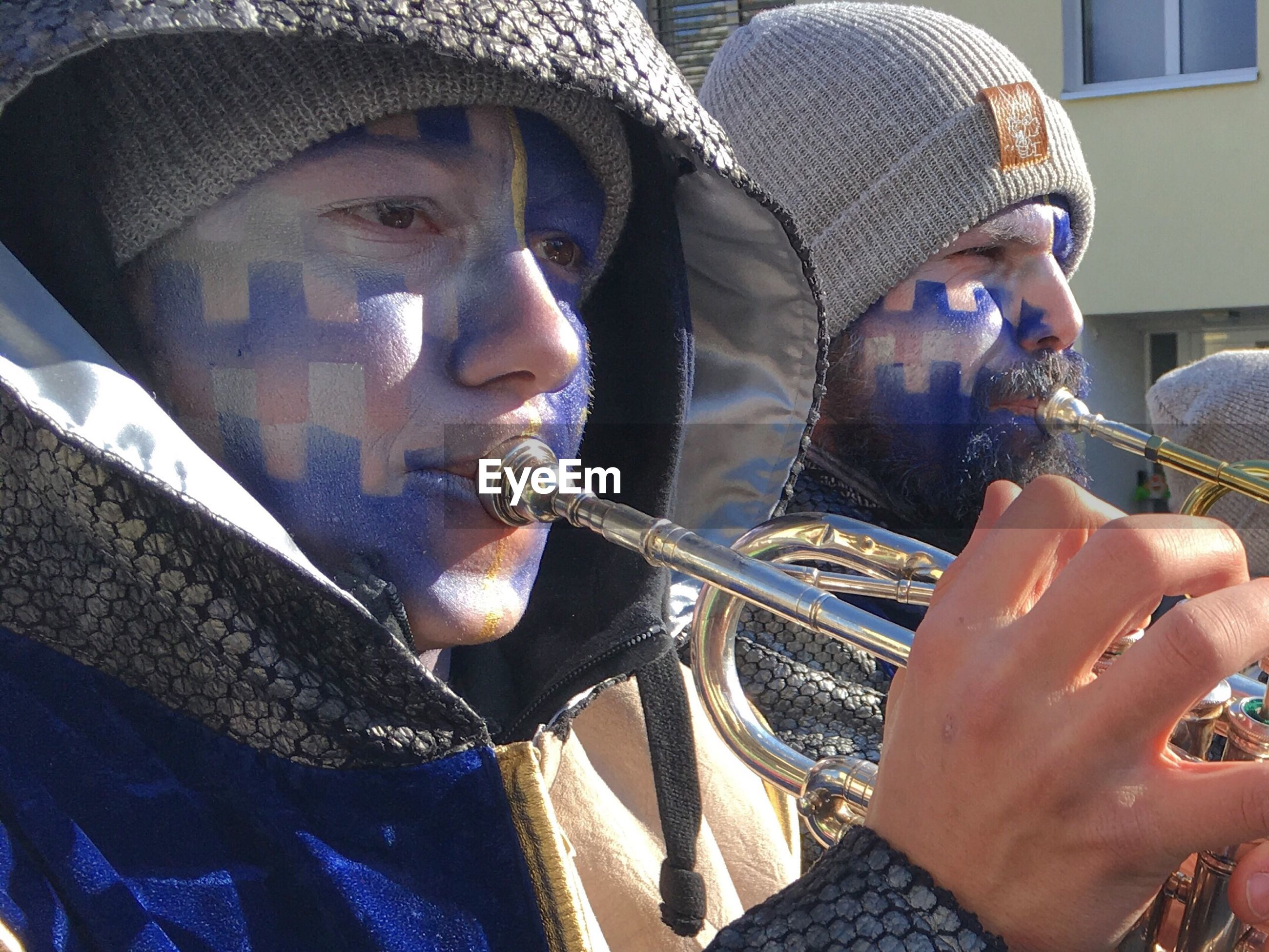 Men playing musical instruments during event