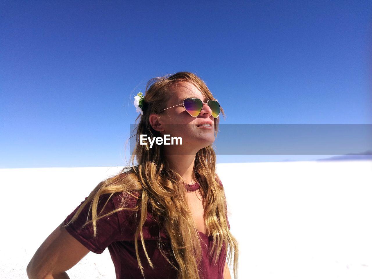Beautiful Young Woman Standing Salar De Uyuni Against Clear Blue Sky