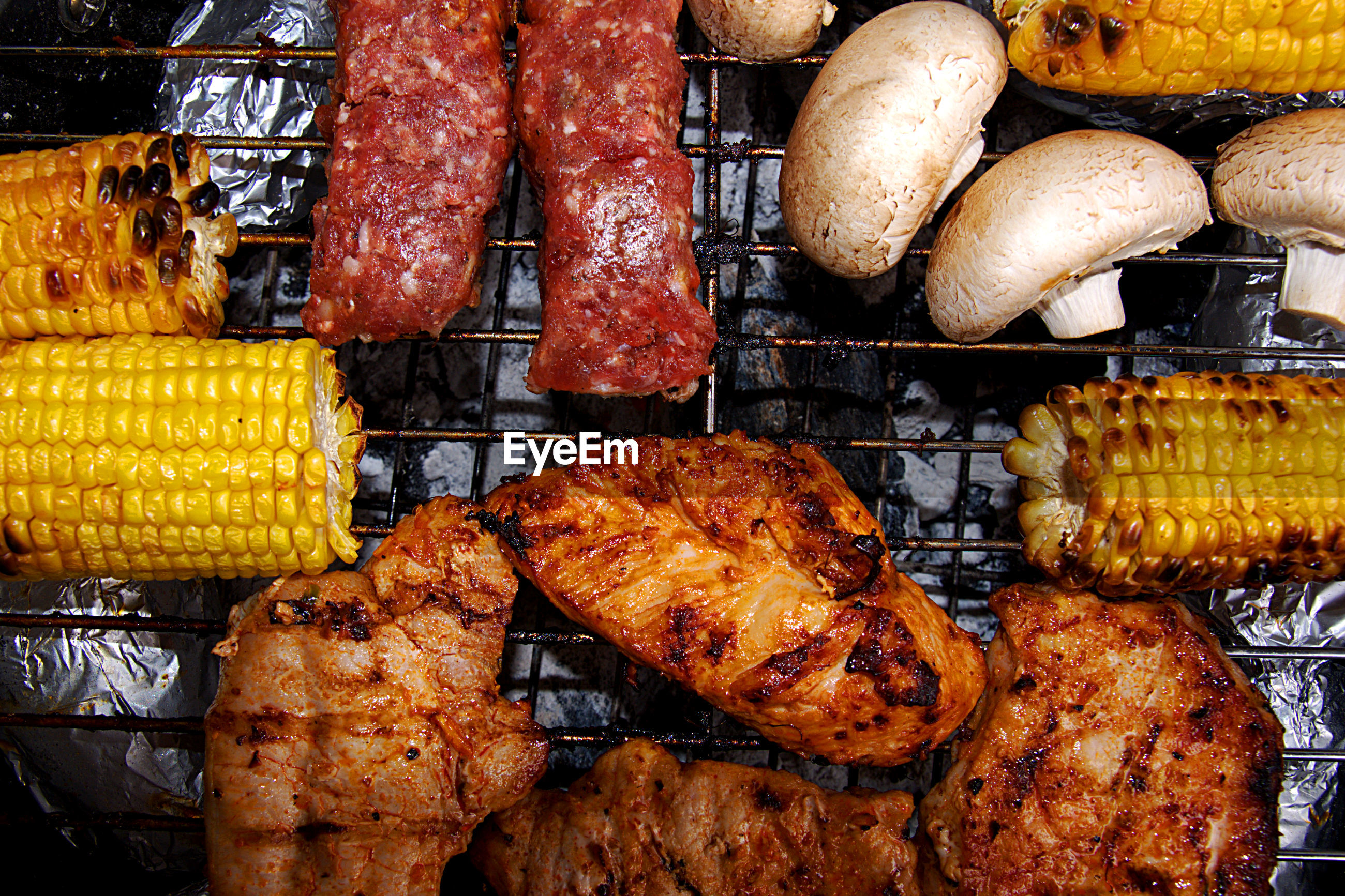 Directly above view of food grilling on barbeque
