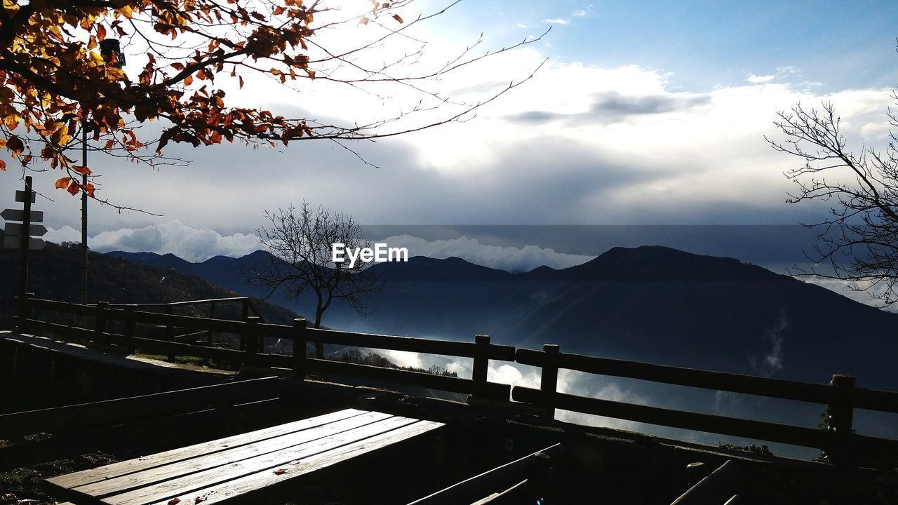 mountain, railing, nature, beauty in nature, no people, mountain range, scenics, sky, day, landscape, tree, outdoors