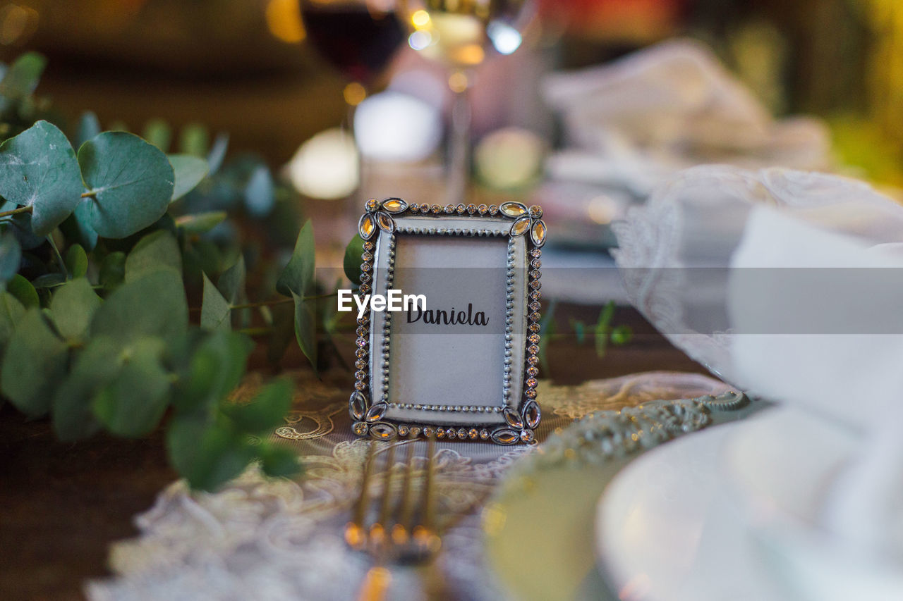 Close-up of text in frame over table