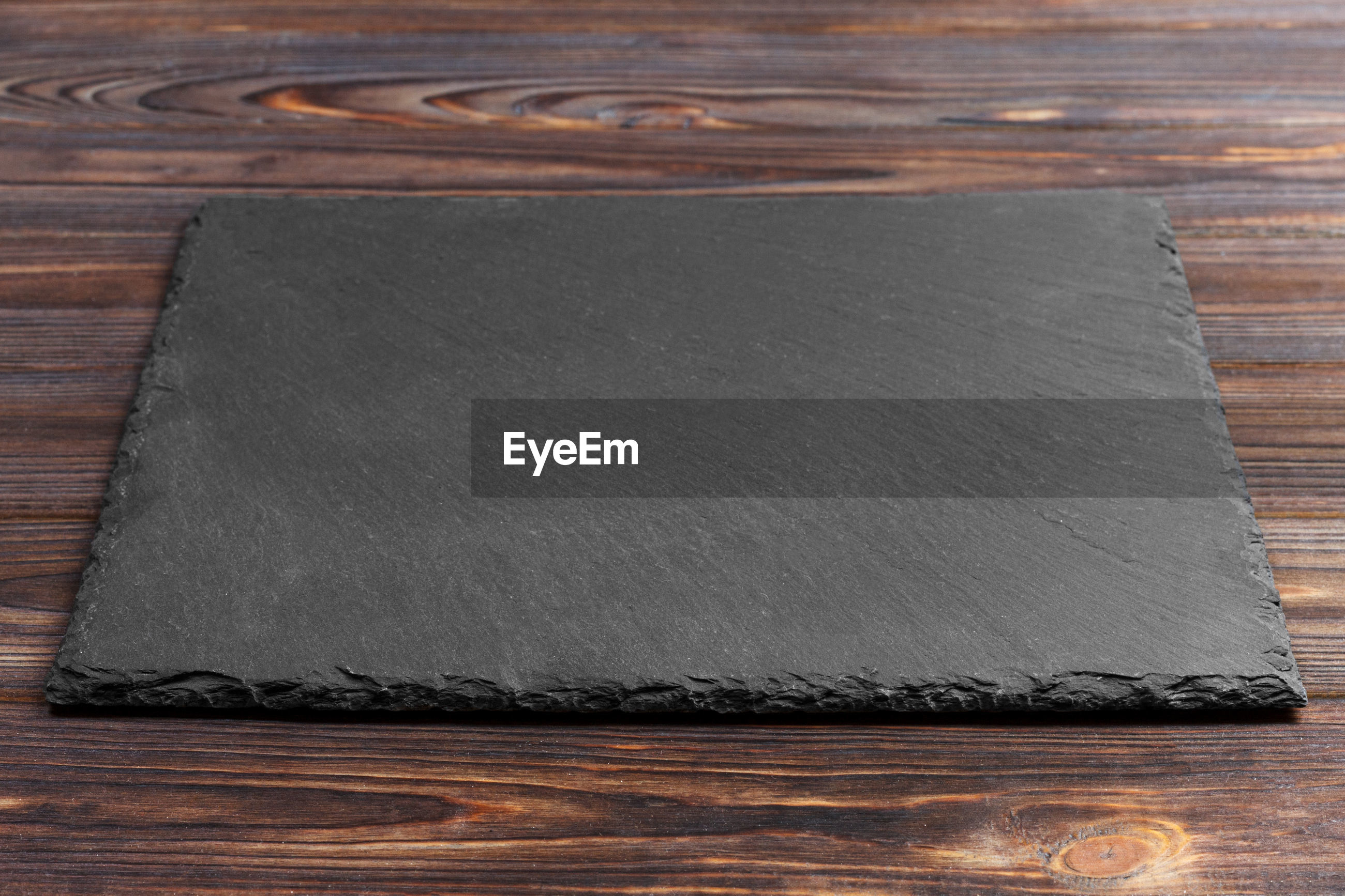Close-up of slate on wooden table