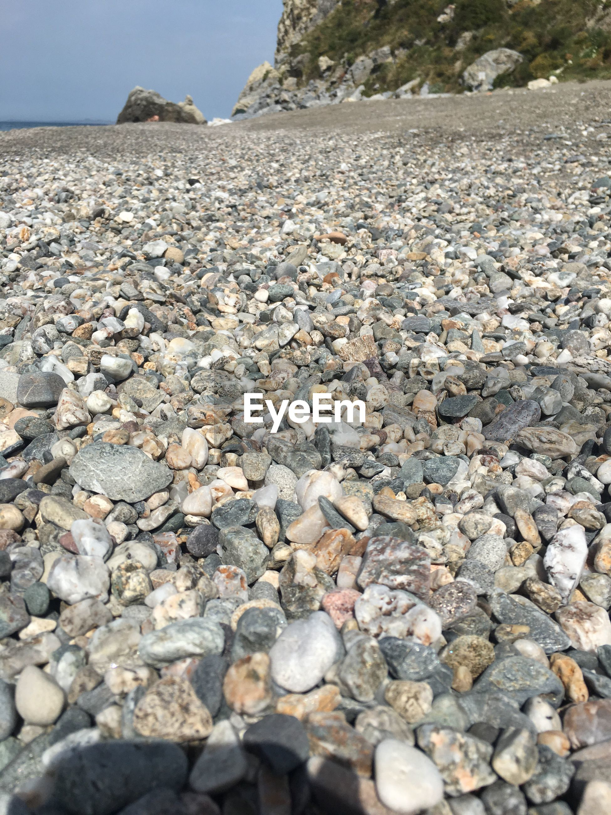 rock - object, pebble, stone - object, shore, beach, pebble beach, nature, outdoors, day, no people, sea, water, beauty in nature, sky, close-up