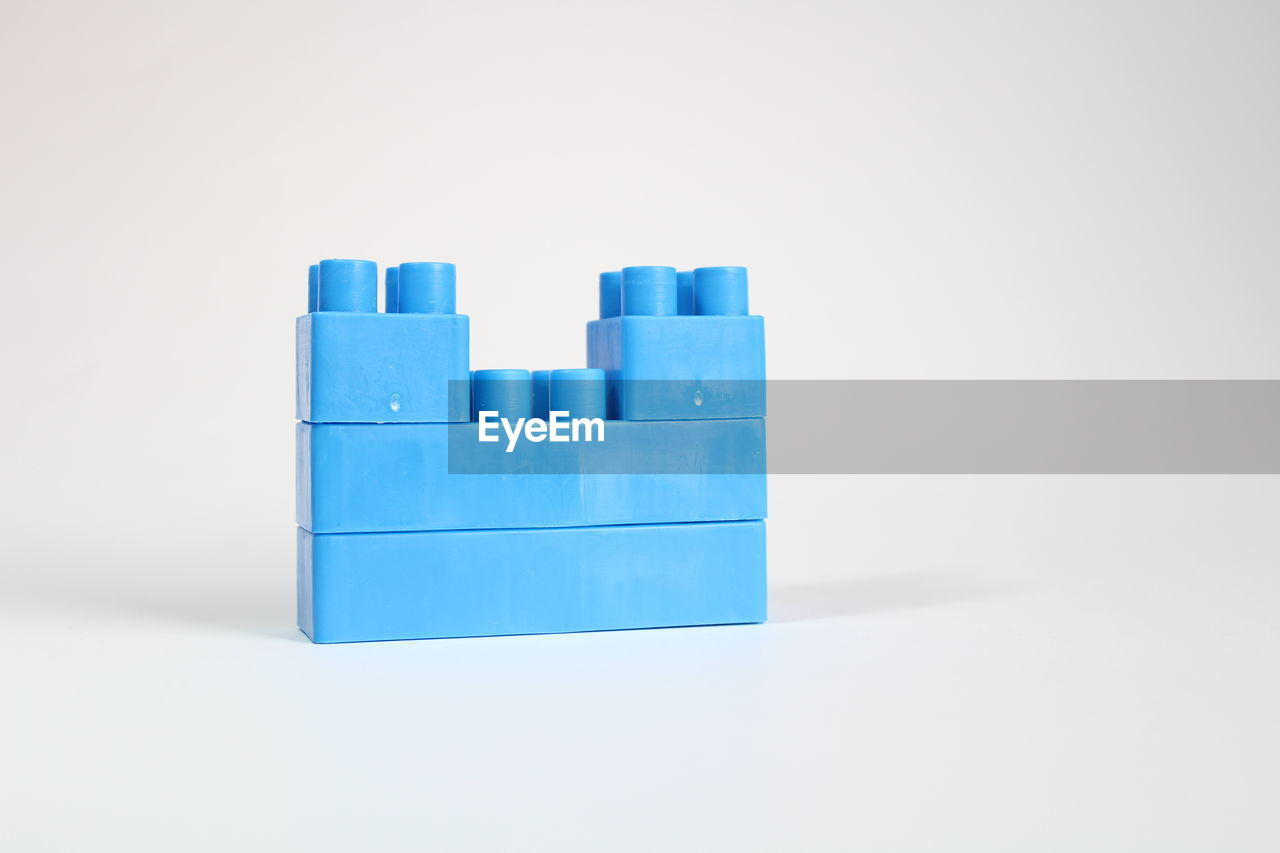 Close-up of toy block over white background