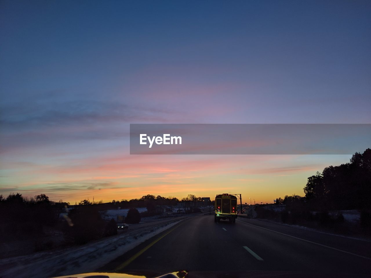 sky, transportation, sunset, road, cloud - sky, the way forward, direction, mode of transportation, nature, no people, car, motor vehicle, land vehicle, orange color, tree, motion, on the move, highway, plant, diminishing perspective, outdoors, multiple lane highway