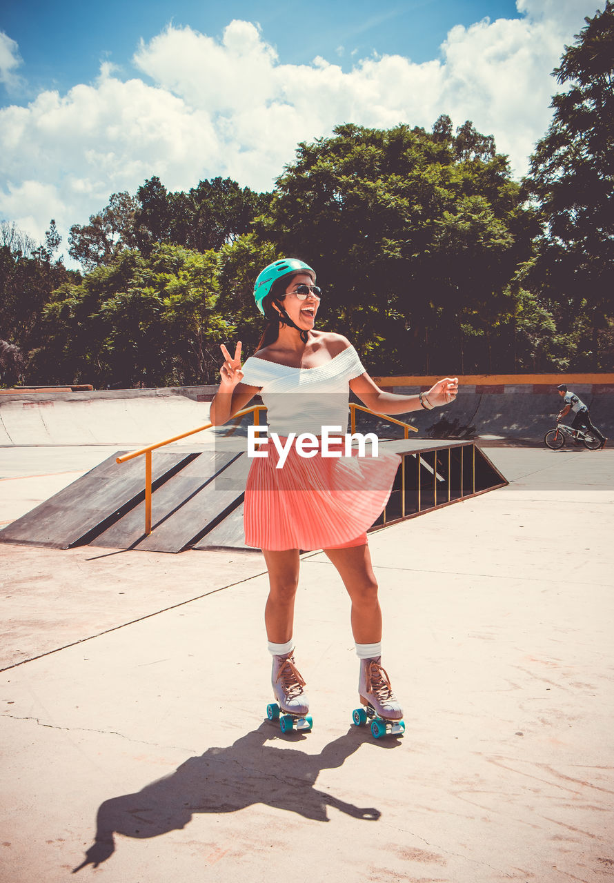 Cheerful Woman Skating At Skateboard Park