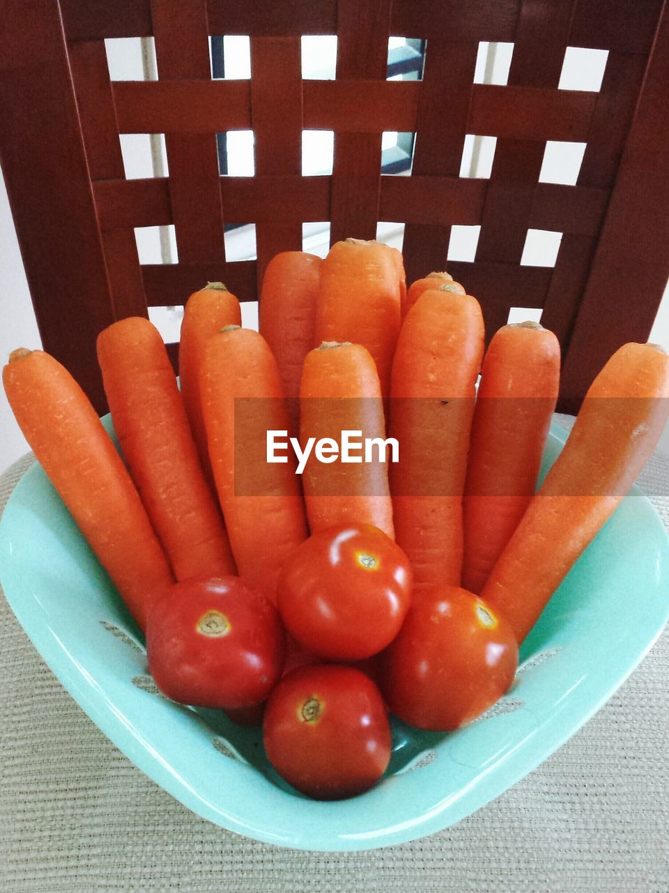 Close-up of fresh carrots with tomatoes