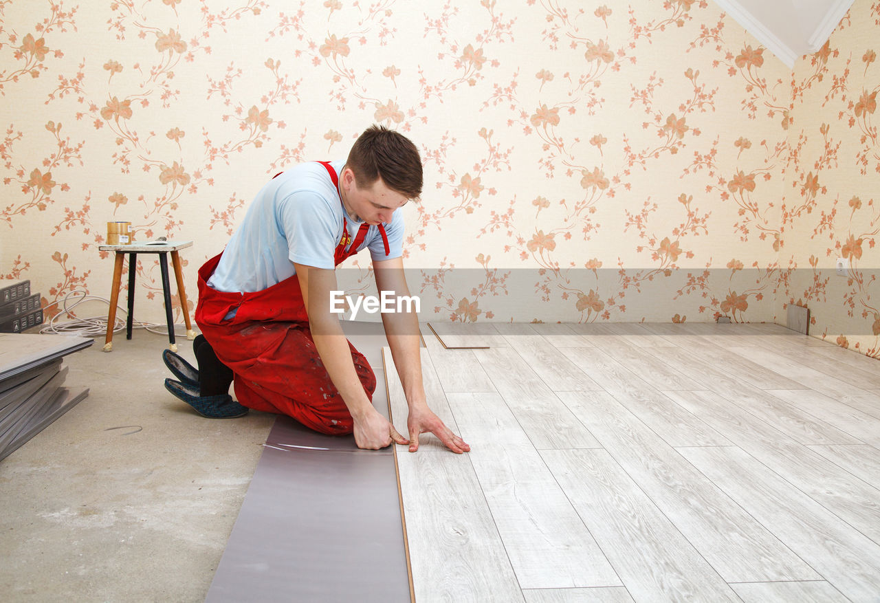 Carpenter working in incomplete home