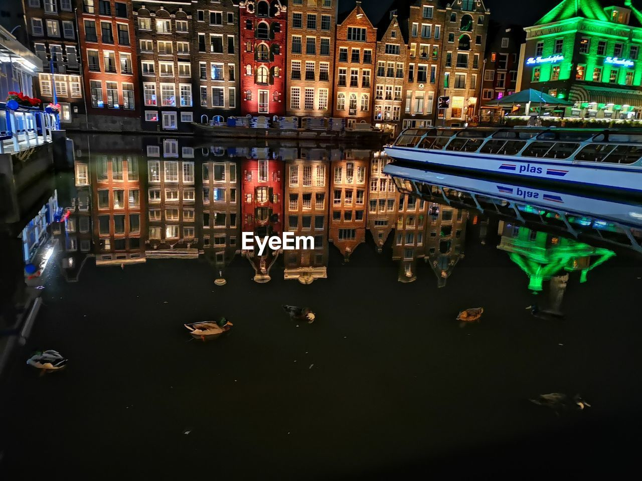 REFLECTION OF ILLUMINATED BUILDINGS IN CANAL