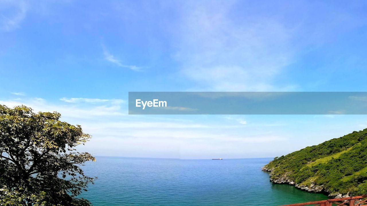 water, sky, scenics - nature, beauty in nature, tranquil scene, sea, tranquility, tree, plant, cloud - sky, blue, day, nature, idyllic, horizon over water, land, no people, horizon, non-urban scene, outdoors