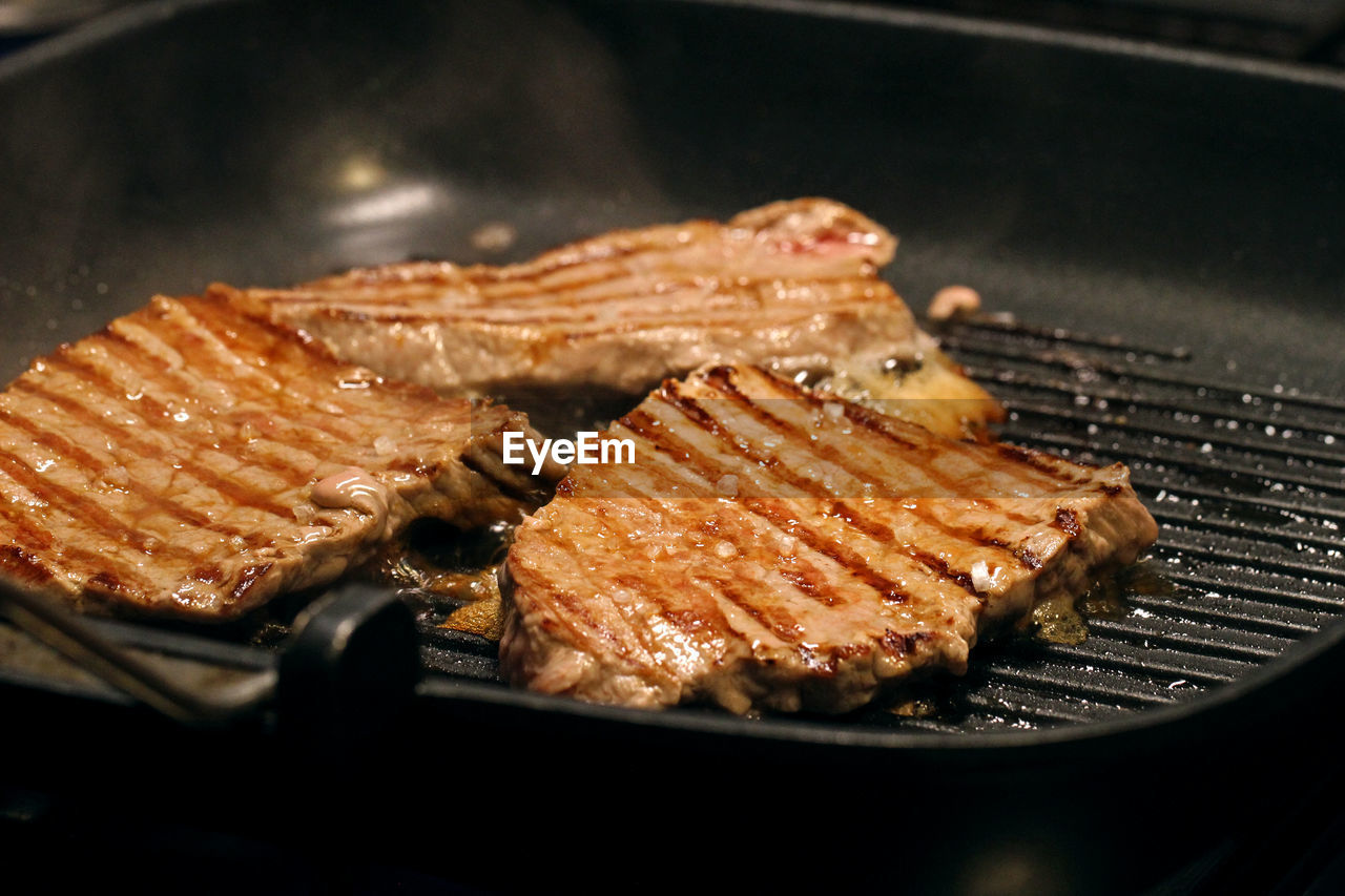 Close-Up Of Grilled Beef Steak On Pan