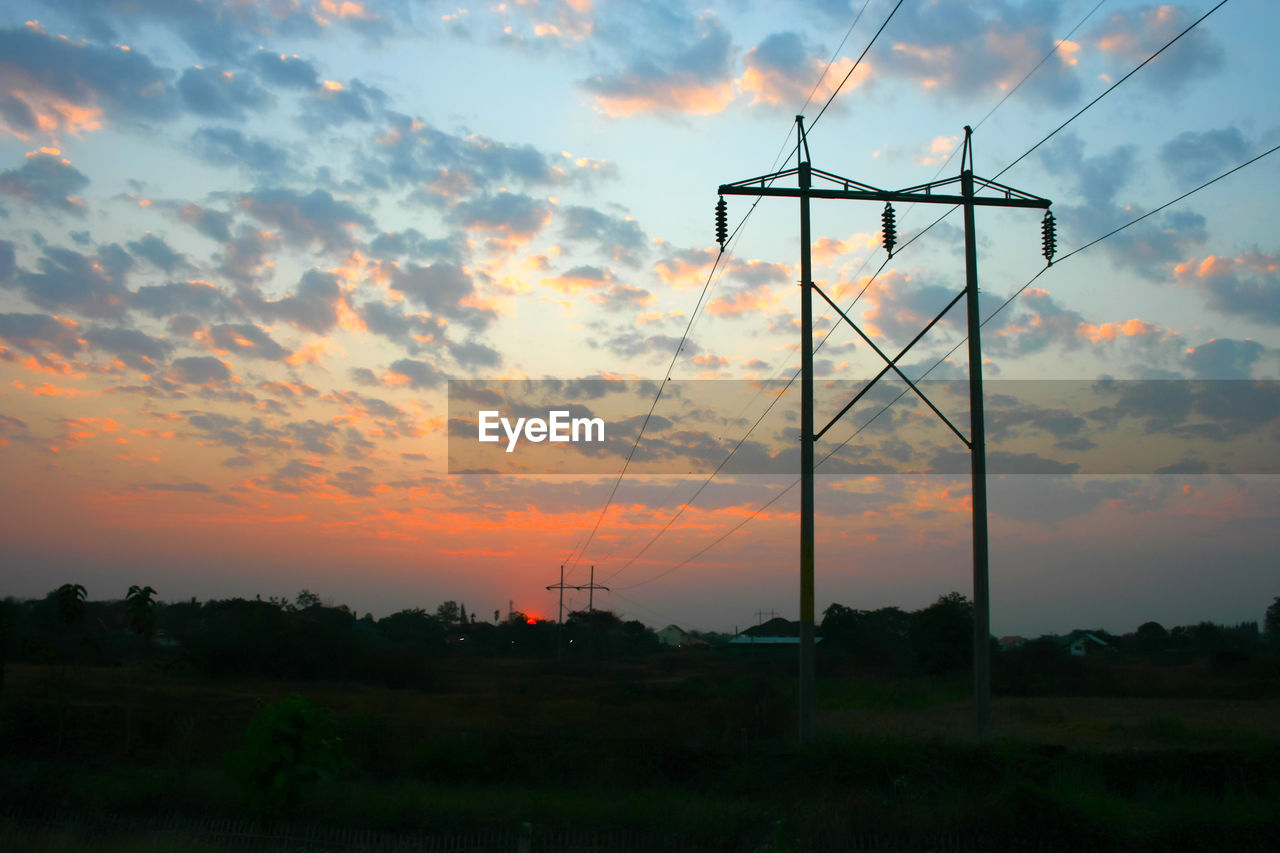 sunset, sky, cloud - sky, beauty in nature, orange color, scenics - nature, nature, fuel and power generation, tranquility, silhouette, no people, tranquil scene, field, landscape, land, technology, environment, outdoors, electricity, idyllic, power supply
