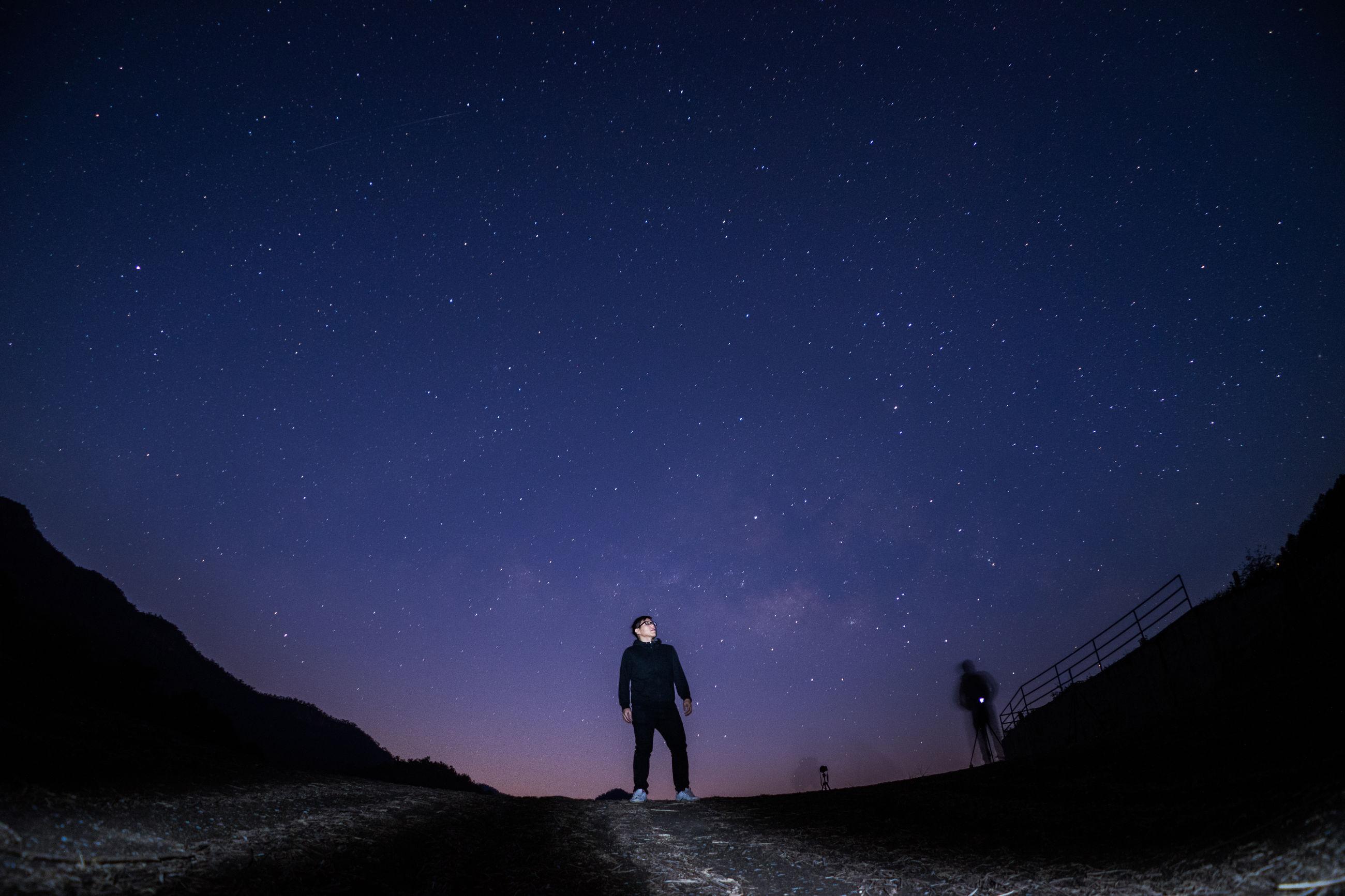 Full length of man walking against star field at night