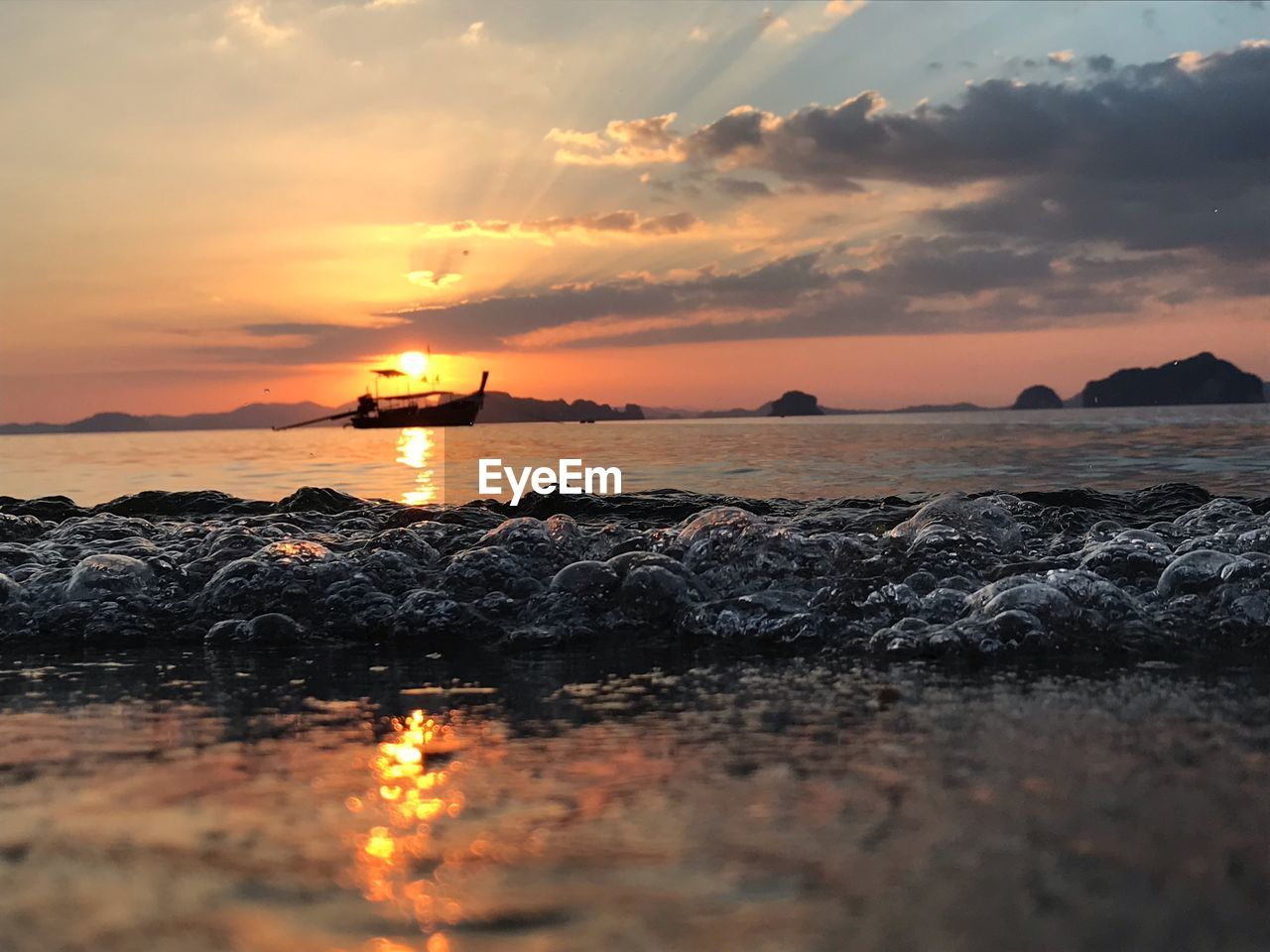 sunset, sky, water, sea, scenics - nature, beauty in nature, orange color, cloud - sky, tranquil scene, tranquility, rock, beach, idyllic, nature, solid, land, horizon over water, no people, rock - object, sun, outdoors