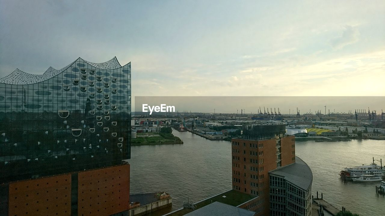 architecture, built structure, building exterior, city, sky, water, cityscape, skyscraper, no people, river, cloud - sky, day, outdoors, modern, nautical vessel
