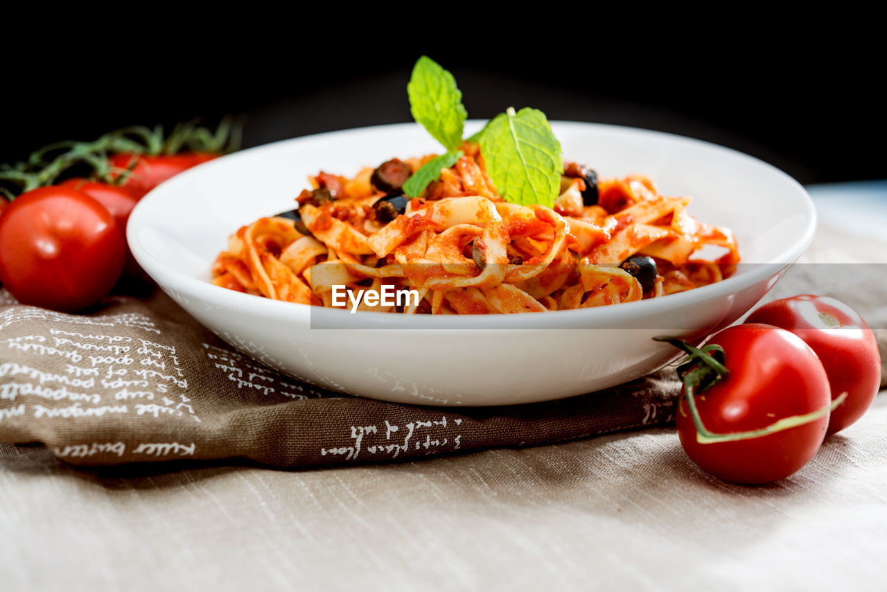 food and drink, food, freshness, pasta, tomato, italian food, still life, healthy eating, table, no people, vegetable, indoors, bowl, basil, ready-to-eat, serving size, close-up, plate