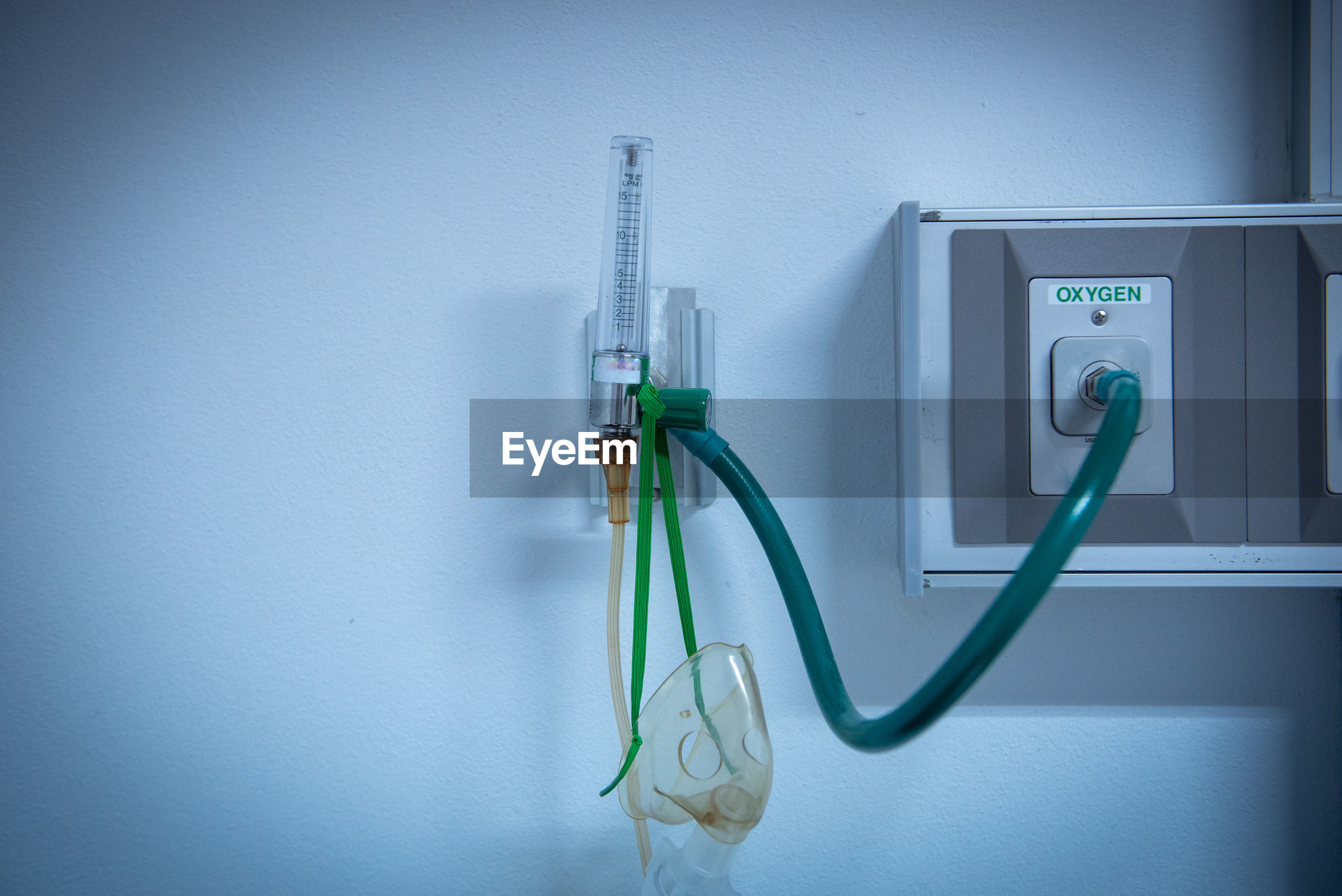 Close-up of oxygen tank mounted on wall