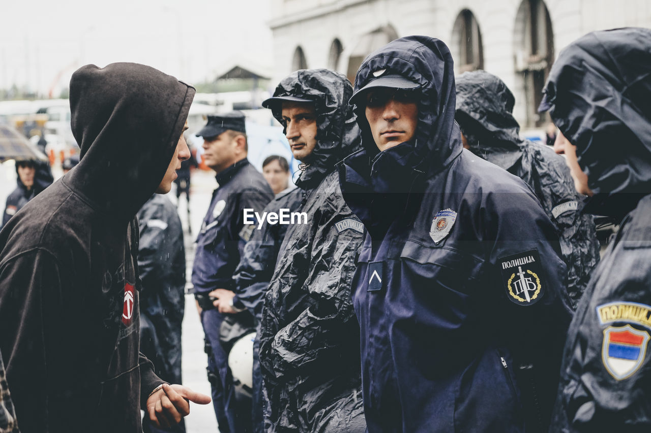 police force, medium group of people, men, day, standing, real people, togetherness, outdoors, police uniform, young adult, riot, people