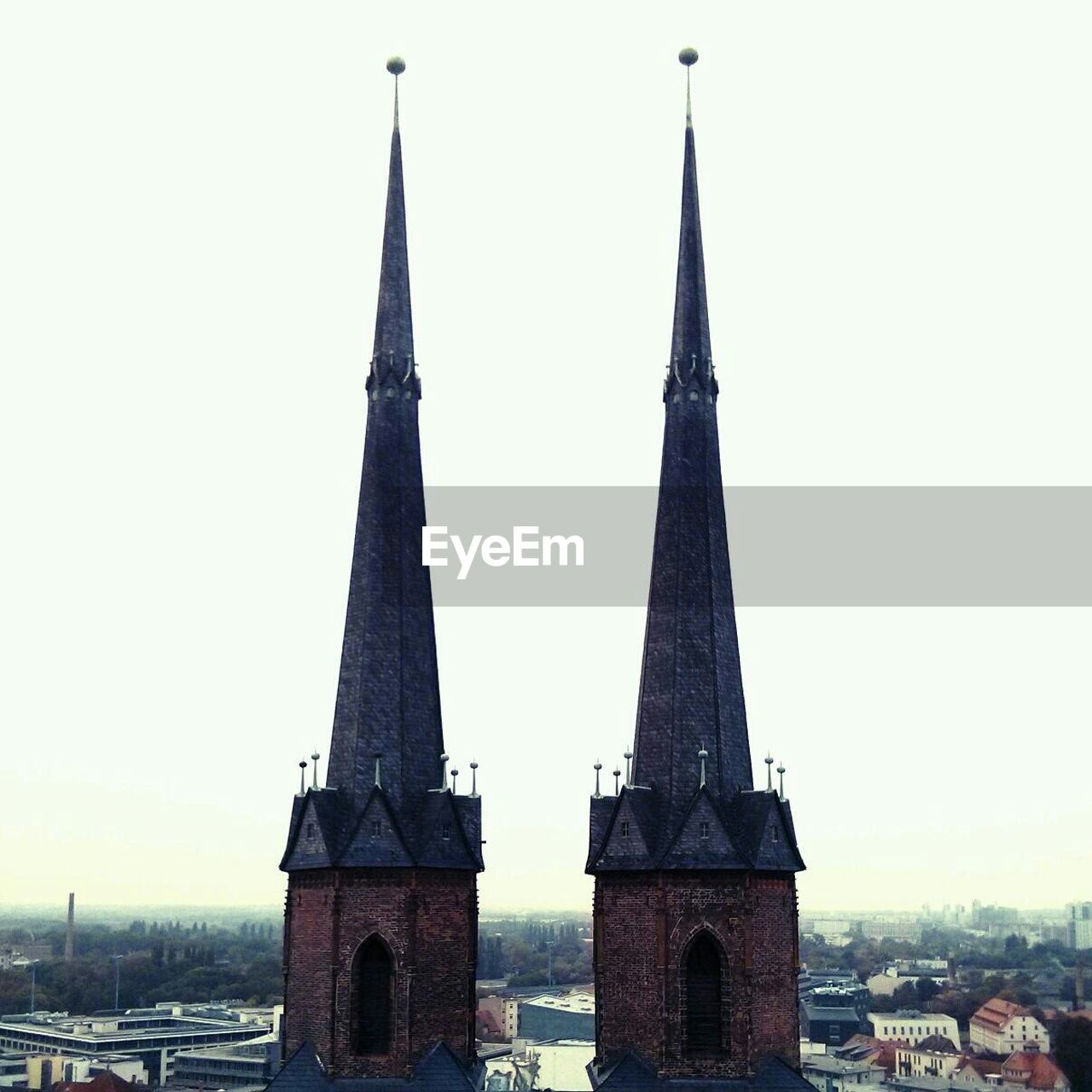 View of twin steeples against clear sky