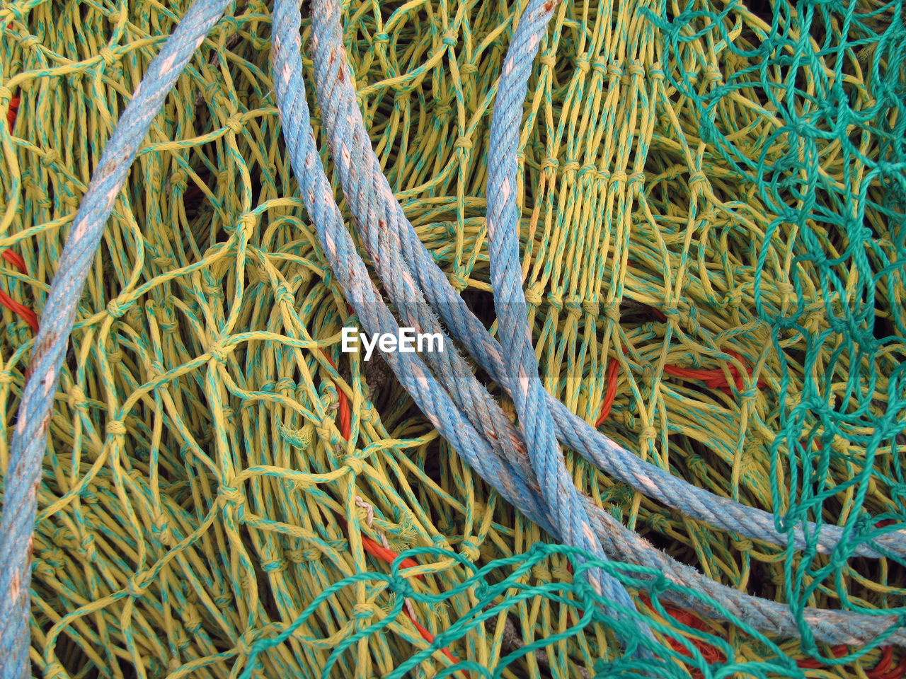 High Angle View Of Rope On Fishing Net
