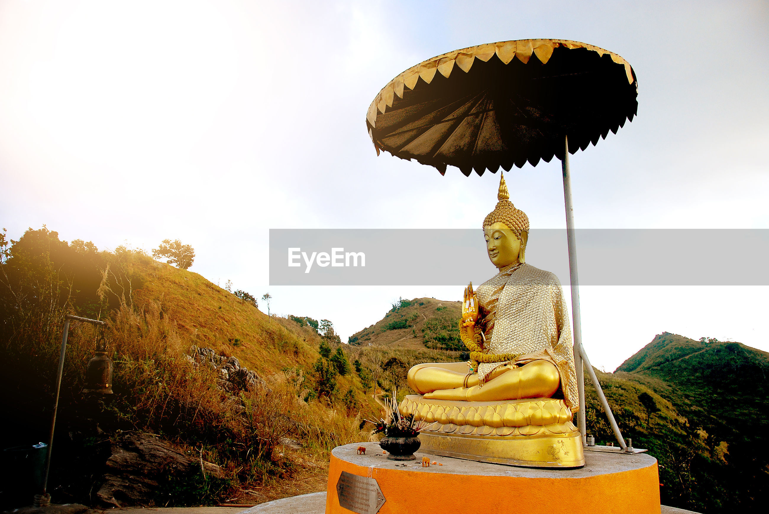 religion, statue, gold colored, no people, gold, idol, outdoors, sculpture, sky, nature, day