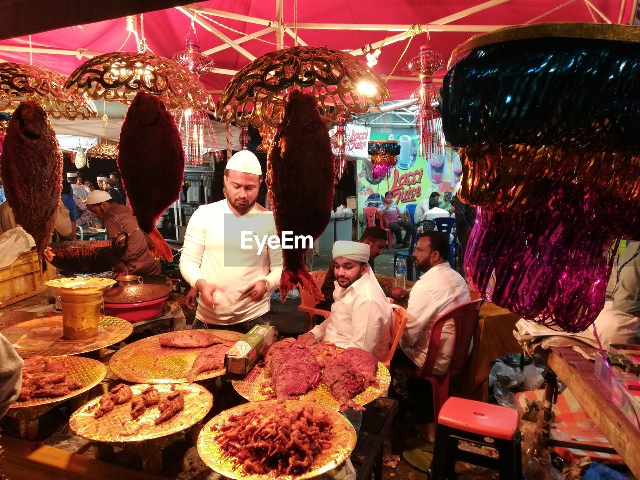 real people, group of people, women, men, adult, retail, market, business, choice, food and drink, people, food, variation, market stall, lifestyles, small business, freshness, illuminated, group, buying, retail display