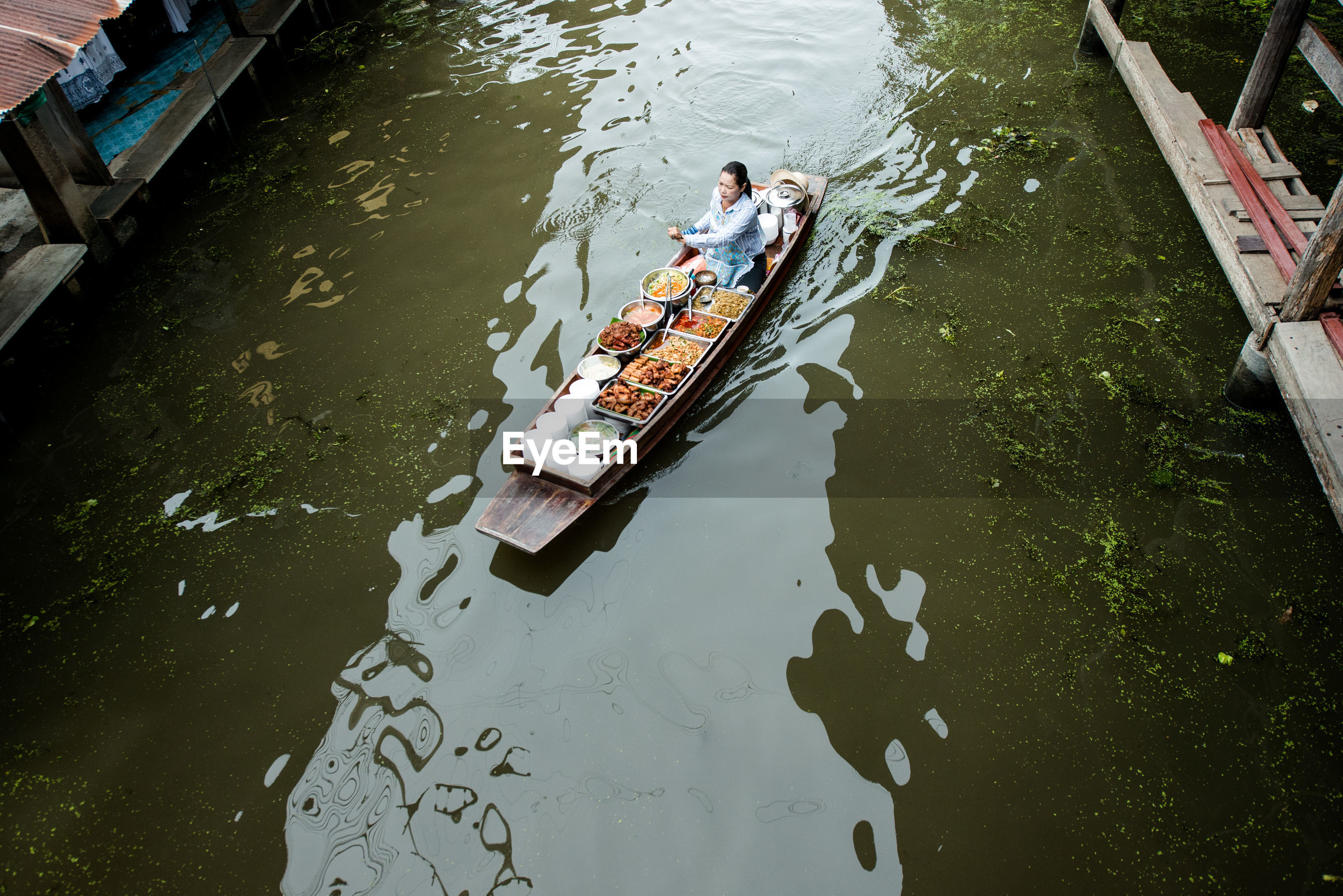 high angle view, water, canal, outdoors, transportation, nautical vessel, men, day, nature, real people, floating on water, one person, gondola - traditional boat, rowing, adult, people