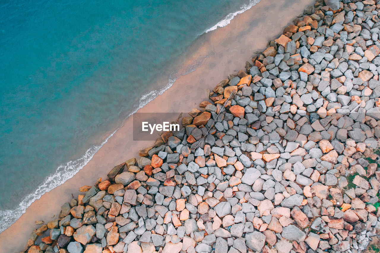 Aerial view of stones at beach