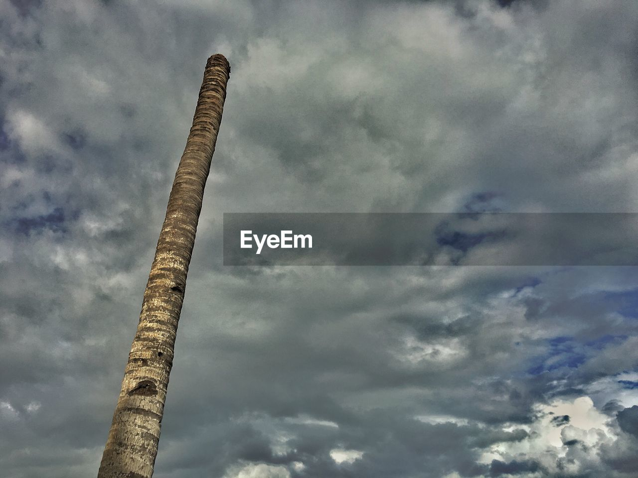 cloud - sky, sky, low angle view, day, outdoors, no people, smoke stack, industry, architecture, nature