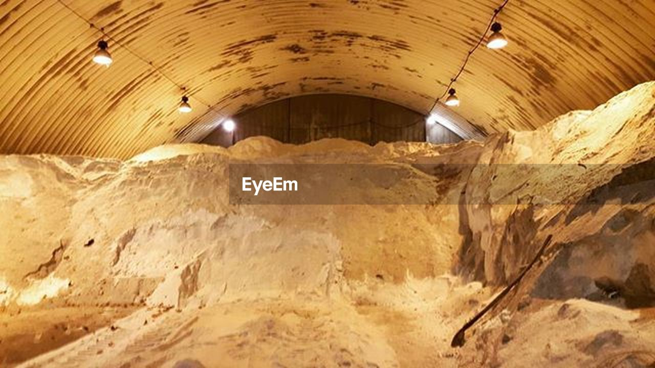ceiling, indoors, rock - object, architecture, cellar, no people, illuminated, space, basement, day