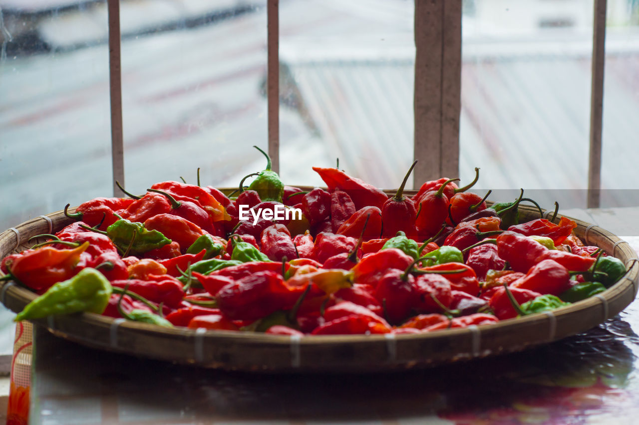 food and drink, freshness, food, red, healthy eating, wellbeing, close-up, fruit, vegetable, no people, still life, day, selective focus, focus on foreground, tomato, large group of objects, abundance, container, pepper, table