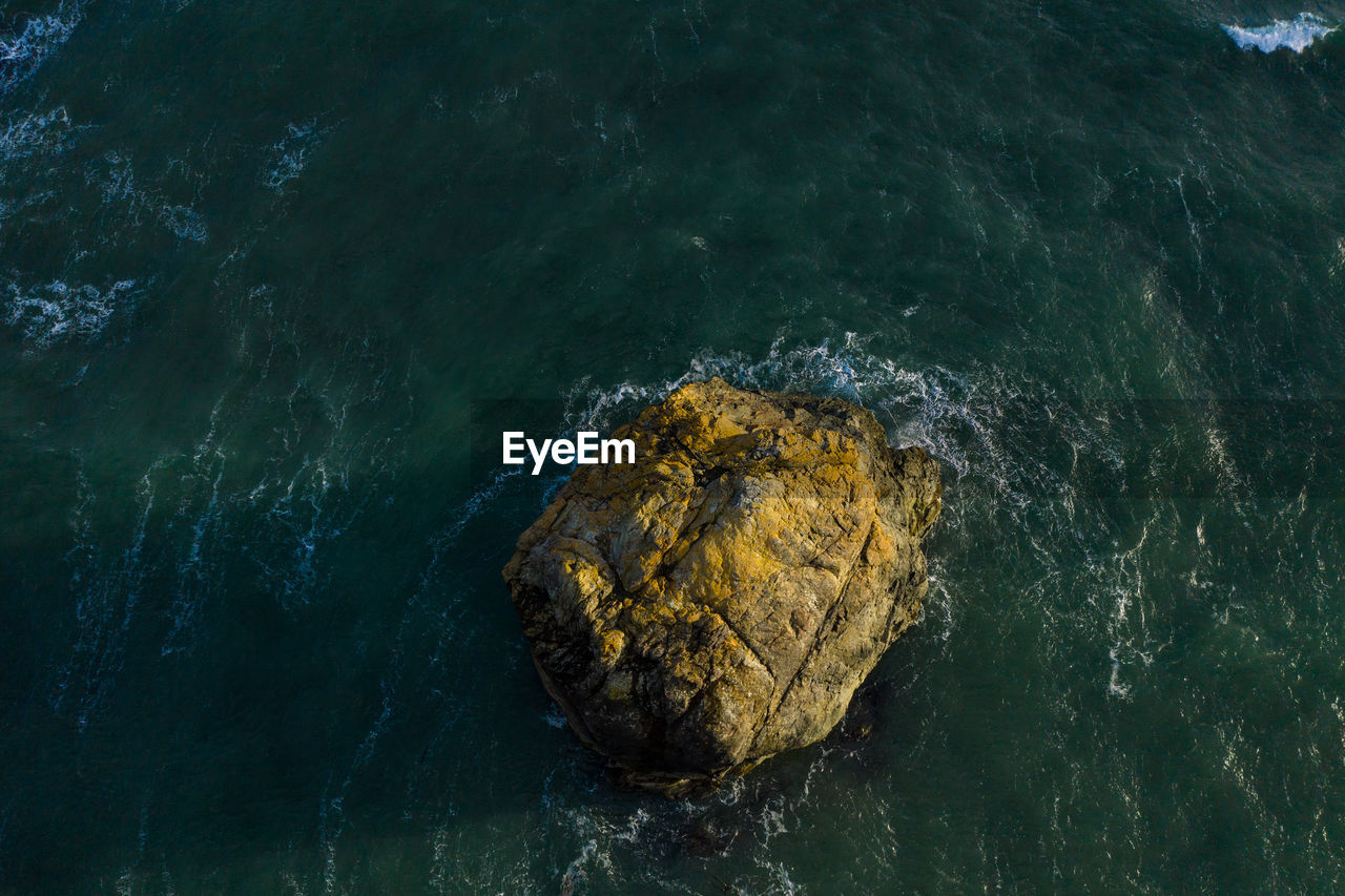water, sea, rock, solid, rock - object, no people, nature, motion, high angle view, beauty in nature, waterfront, day, rock formation, outdoors, wave, tranquility, land, close-up, geology, power in nature, marine