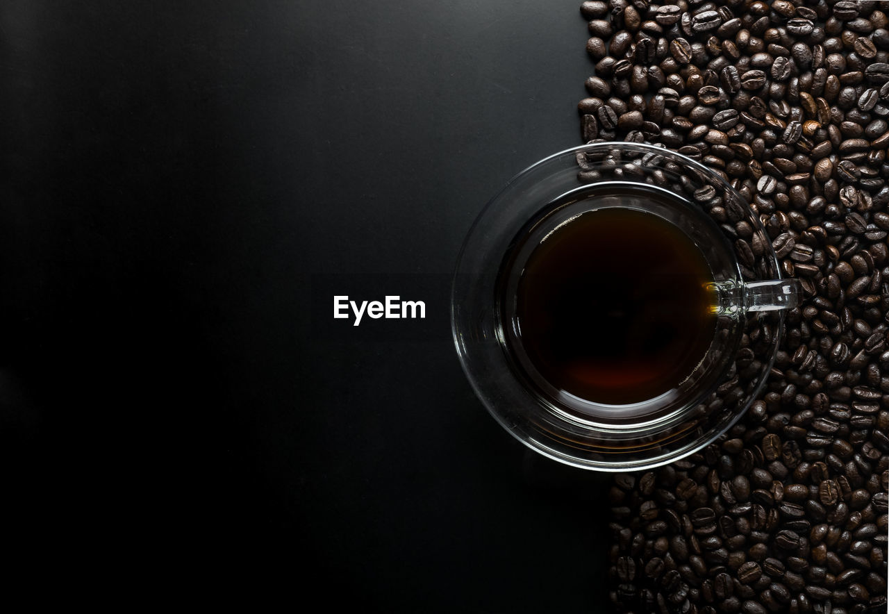 food and drink, refreshment, coffee, drink, still life, coffee - drink, roasted coffee bean, indoors, food, freshness, container, cup, no people, close-up, brown, glass, glass - material, high angle view, coffee bean, table, caffeine, black background, black tea