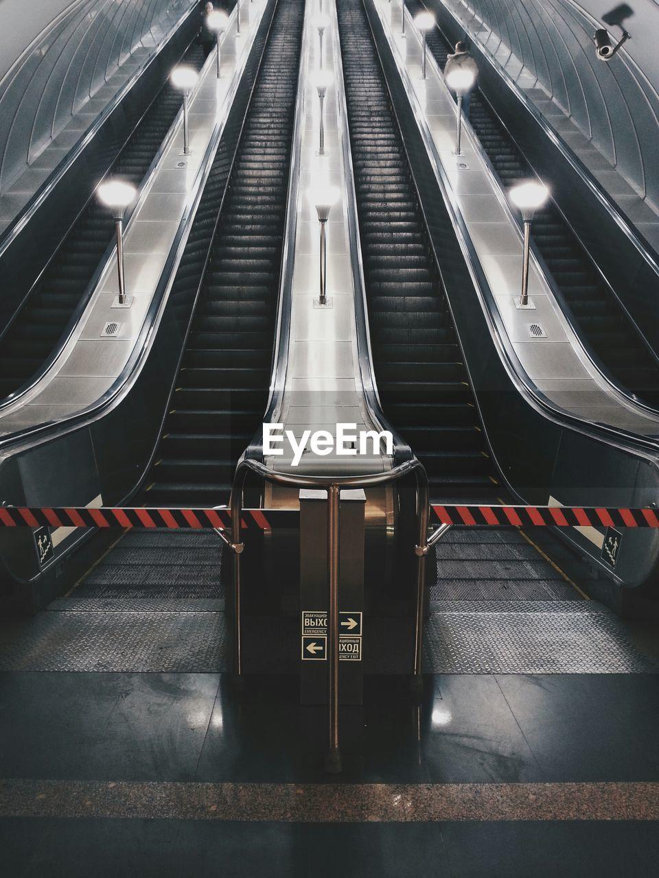 Symmetrical View Of Escalators In Underground Station