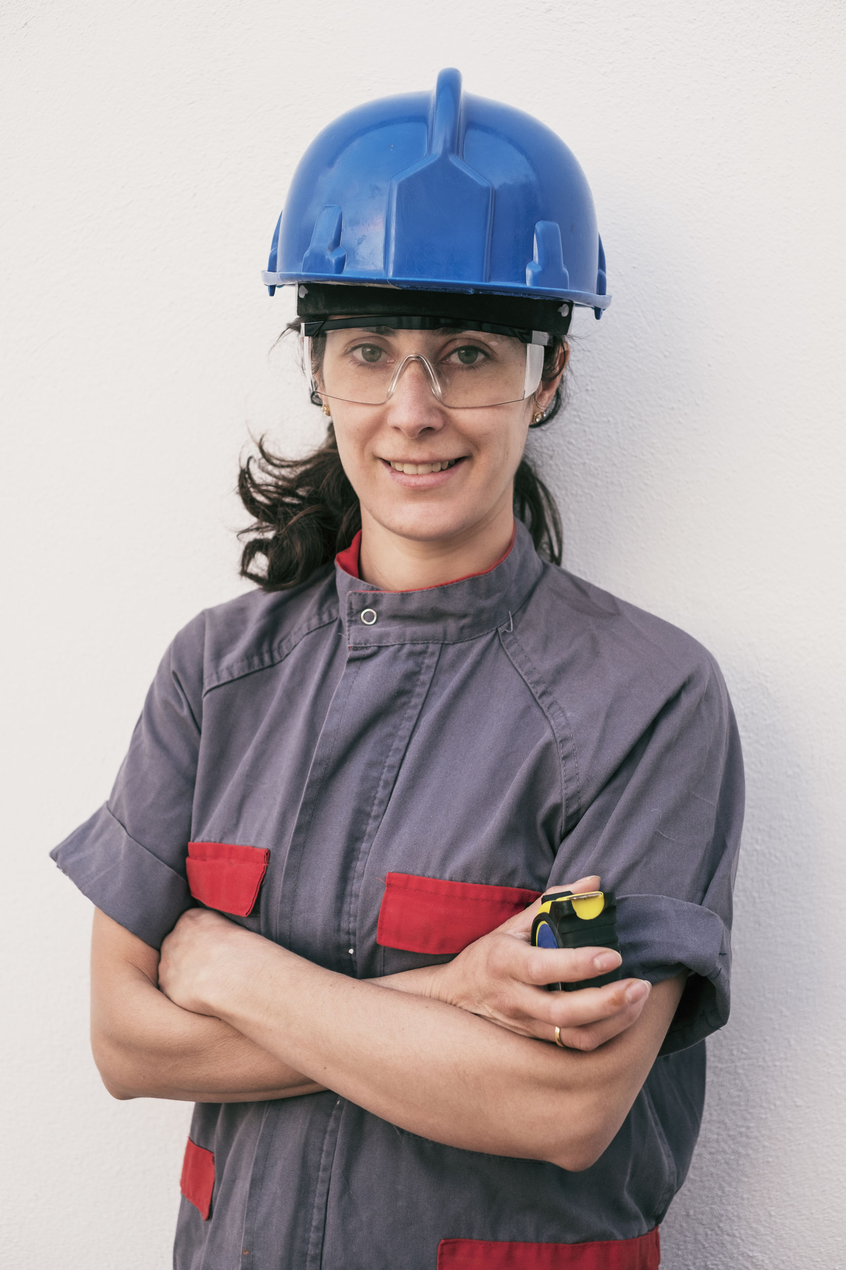 Portrait of manual worker standing against white background