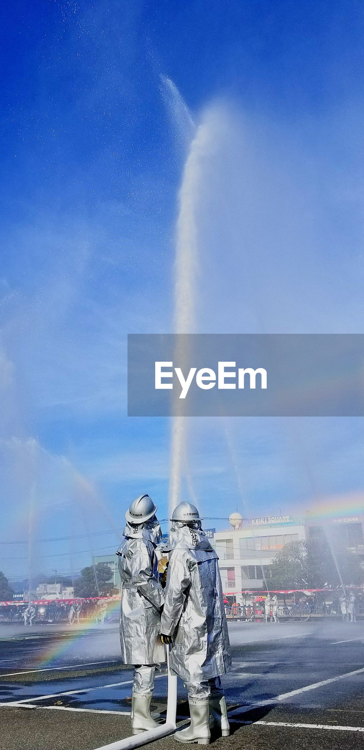 vapor trail, day, transportation, outdoors, protective workwear, sky, men, spraying, one person, people