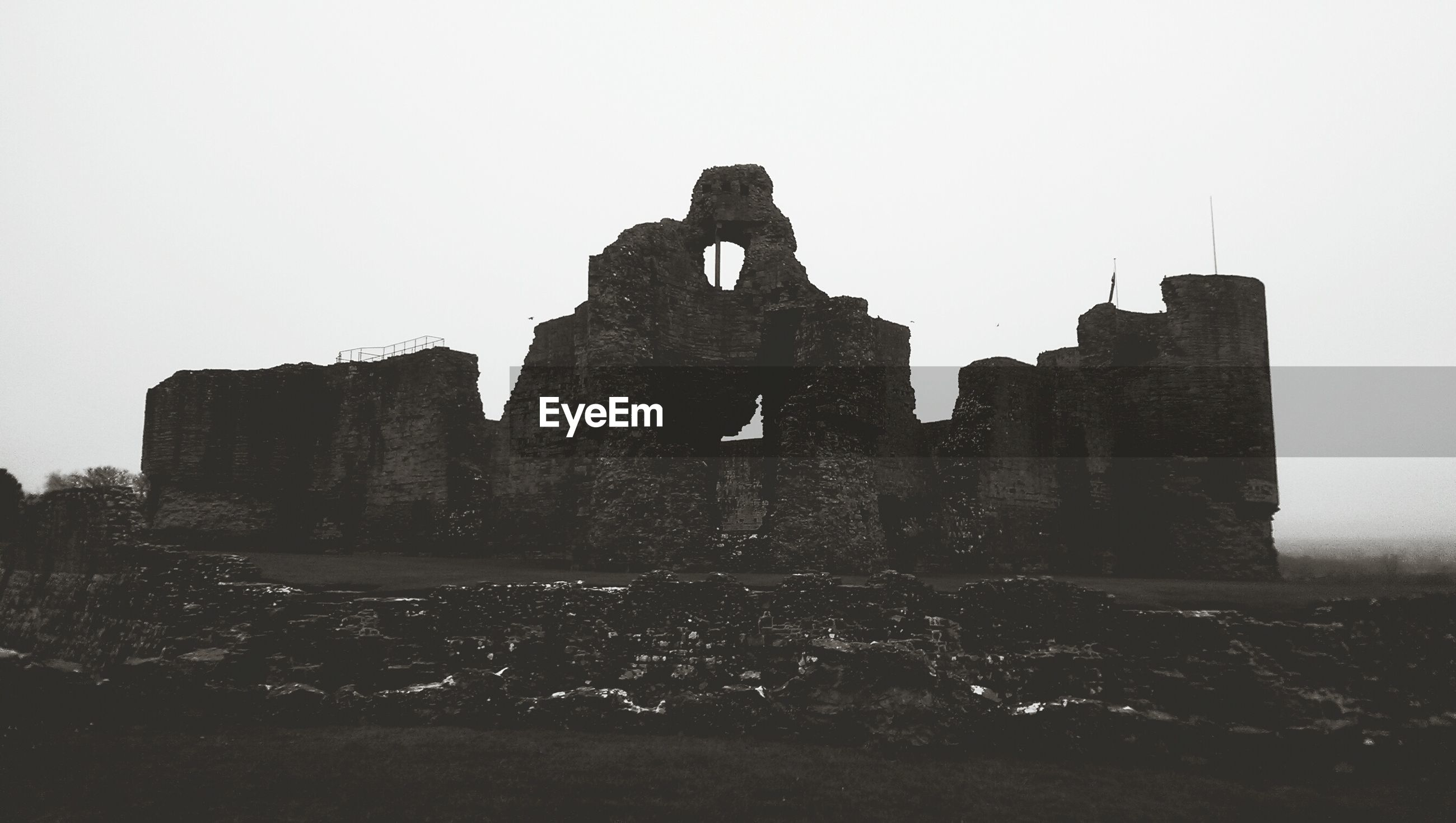 Exterior of rhuddlan castle against clear sky