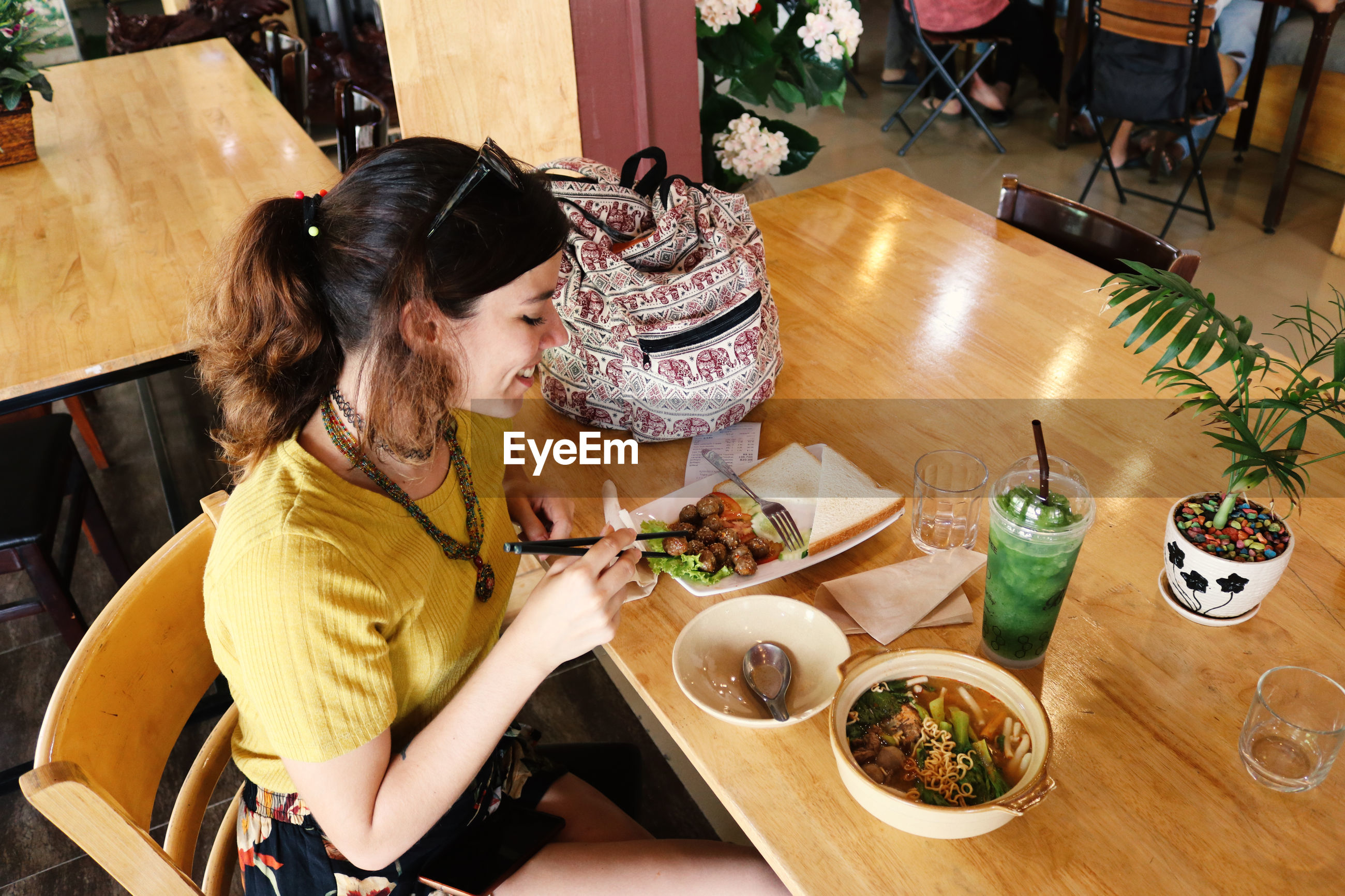High angle view of woman sitting in restaurant