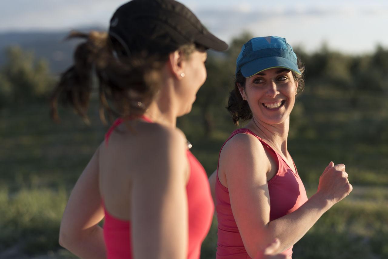 Smiling friends jogging in park