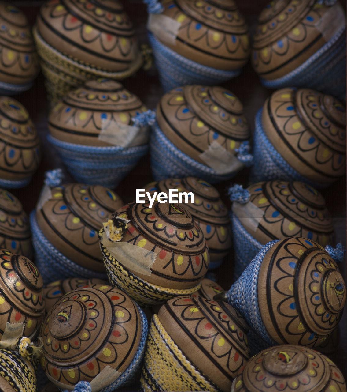 Full frame shot of spinning tops for sale