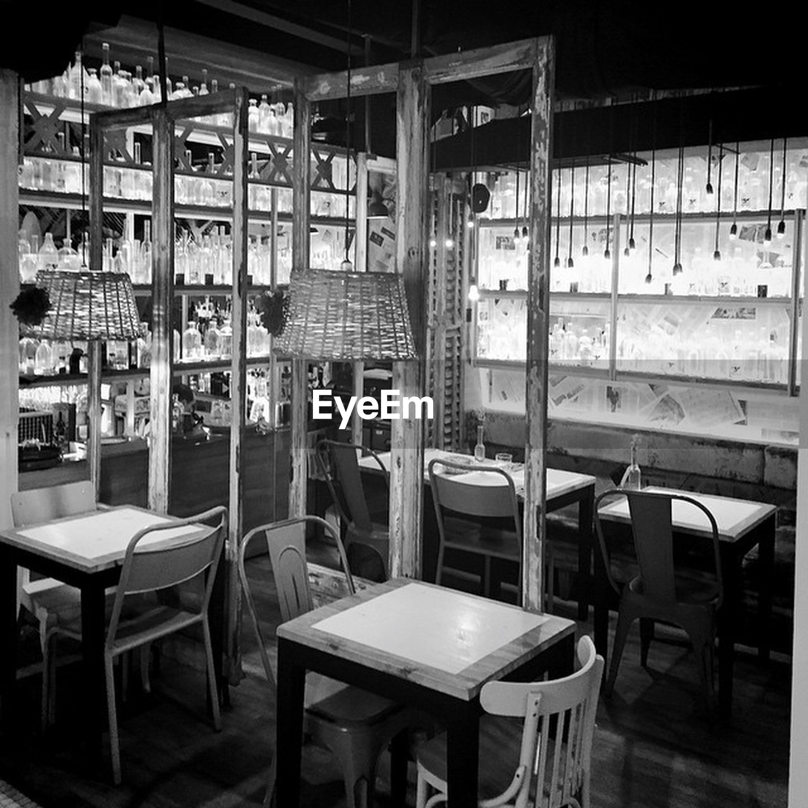 chair, absence, empty, restaurant, shelf, arrangement, interior, in a row, furniture, seat, no people, food and drink industry, day, repetition, side by side, bookshelf, illuminated