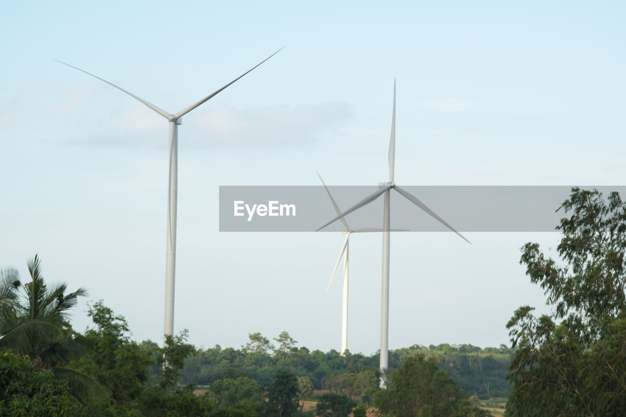 alternative energy, turbine, renewable energy, wind turbine, fuel and power generation, environmental conservation, wind power, environment, sky, tree, plant, nature, day, no people, landscape, outdoors, technology, beauty in nature, sustainable resources, low angle view, power supply