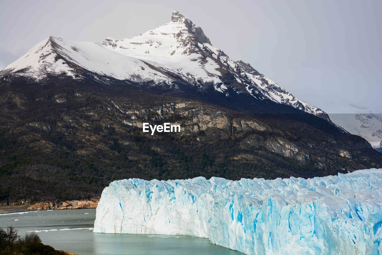 Moreno Glacier With Snowcapped Mountain In Background