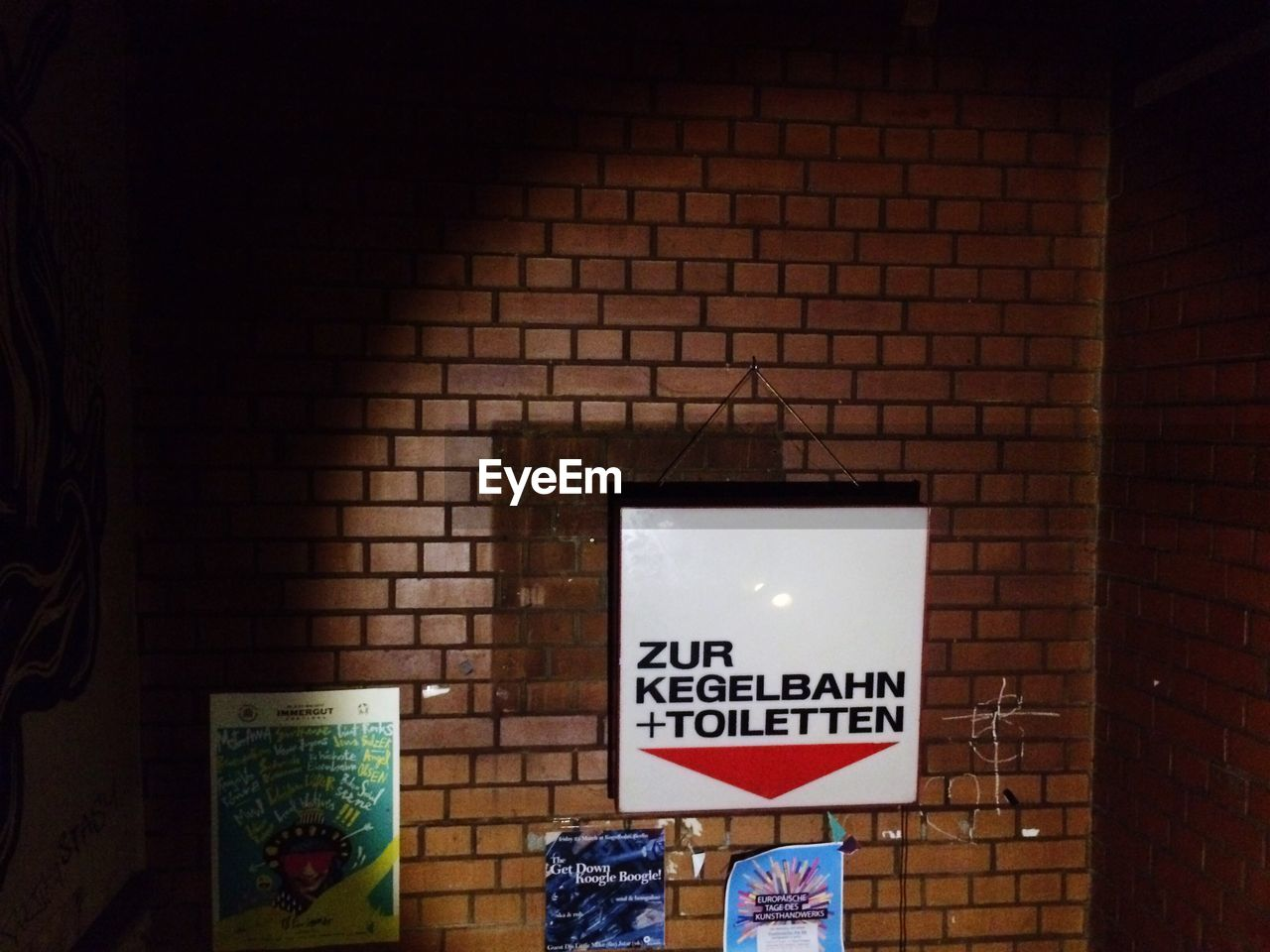 text, brick wall, western script, communication, indoors, no people, illuminated, architecture, day