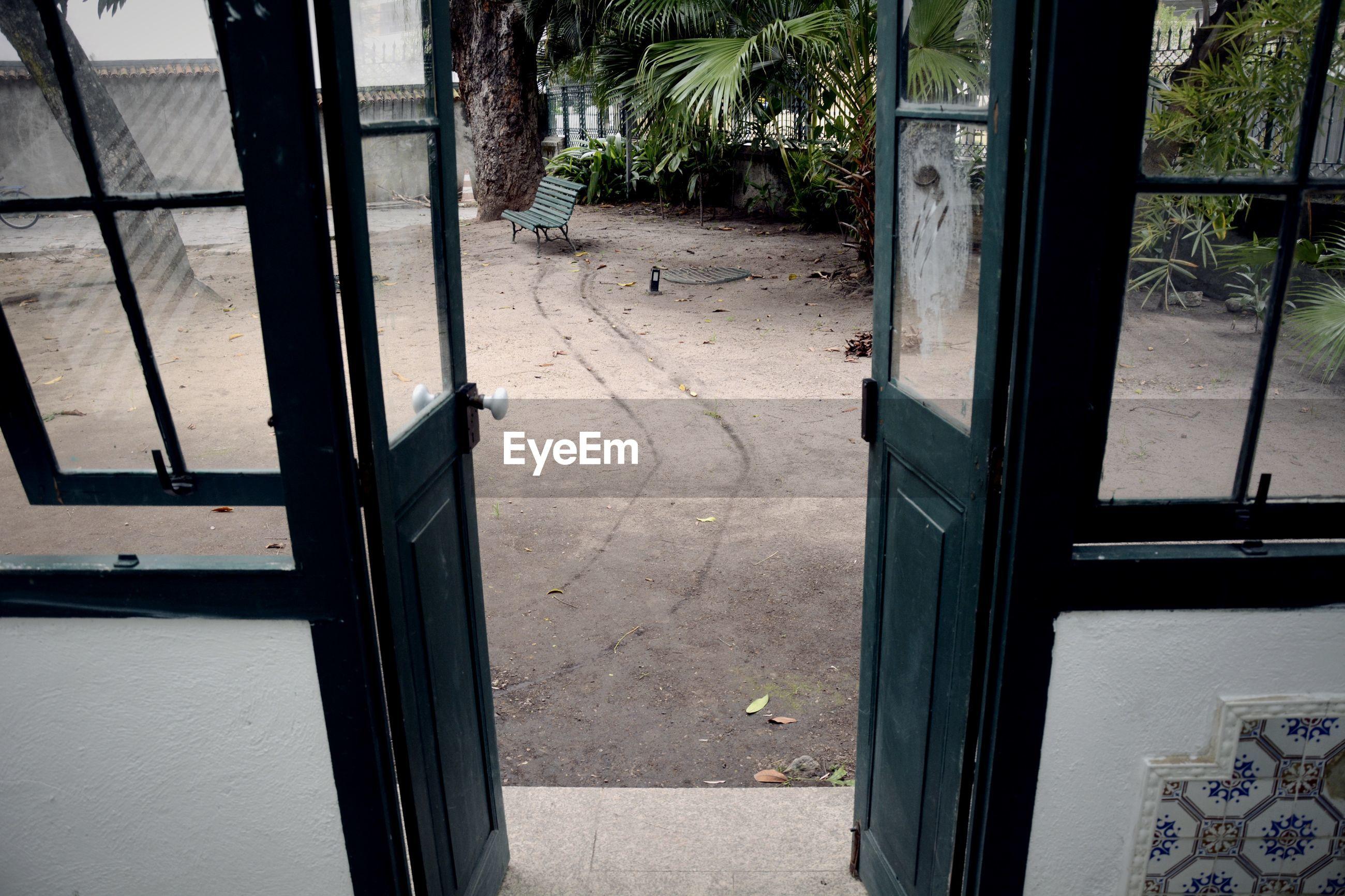Open doorway leading towards yard